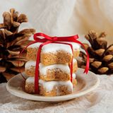 Christmas cookies decorated on wooden background with napkin. And red ribbon, German Zimtsterne Stock Photography
