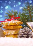 Christmas cookies and decoration . Silver balls and christmas cookies on snow .Christmas decoration stock photo