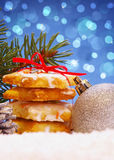 Christmas cookies and decoration . Silver balls and christmas cookies on snow .Christmas decoration royalty free stock image