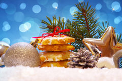 Christmas cookies and decoration . Silver balls and christmas cookies on snow .Christmas decoration royalty free stock photos