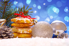 Christmas cookies and decoration . Silver balls and christmas cookies on snow .Christmas decoration royalty free stock photo