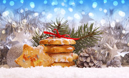 Christmas cookies and decoration . Silver balls and christmas cookies on snow .Christmas decoration stock photography
