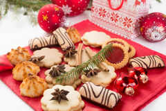 Christmas cookies and decorations. Pile of various christmas cookies and red decorations Royalty Free Stock Photos