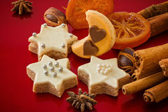 Christmas cookies, in different shapes, with spices, festive red Royalty Free Stock Image