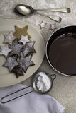 Christmas cookies and a dish of melted chocolate Stock Photos