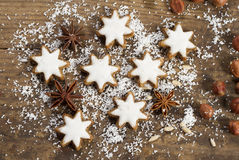 Christmas cookies. Festive background with candies, nuts, cookies on wooden table Royalty Free Stock Photos
