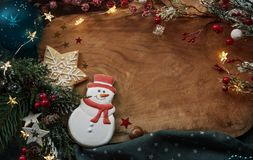 Christmas cookies and festive decor. At the wooden desk stock photography