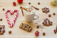 Christmas cookies with festive decoration on wooden background stock images