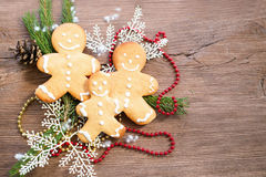 Christmas cookies with festive decoration on wooden table. Royalty Free Stock Photography
