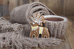 Christmas cookies in the form of a deer and a cup of tea in a sc Royalty Free Stock Image