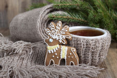 Christmas cookies in the form of a deer and a cup of tea  . Stock Photos