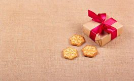 Christmas cookies in the form of snowflakes and a gift box. Festive concept. New Year`s and Christmas. Copy space Royalty Free Stock Photos