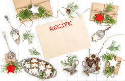 Christmas cookies gifts paper sheet recipe Decoration Flat lay. Christmas cookies, gifts and paper sheet for recipe. Festive decoration. Vintage cutlery. Flat Stock Image