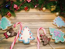 Christmas cookies gingerbread and decoration on wooden backgroun Royalty Free Stock Image