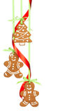 Christmas Cookies. Gingerbread men and christmas tree cookies hanging by ribbon isolated on white stock photo