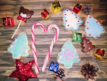 Christmas cookies gingerbread and decoration on wooden backgroun Royalty Free Stock Photo
