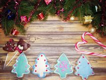 Christmas cookies gingerbread and decoration on wooden backgroun Stock Photo
