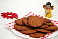 Christmas cookies. Gingersnaps - cookies for Christmas on a white background with angel decoration stock image