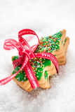 Christmas cookies, glazed christmas tree shape on a snow Stock Photo