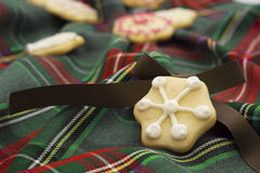 Christmas cookies on green tartan Stock Images