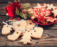 Christmas cookies handmade lies on wooden background. Stock Photos