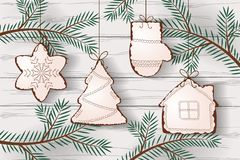 Christmas cookies hanging on the tree branches vector illustration