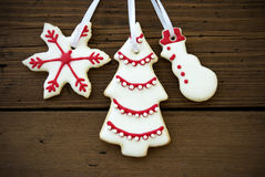 Christmas Cookies Hanging on Wood Closeup Stock Images