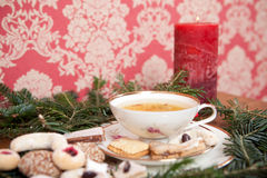 Christmas cookies, Herbal Tea and red candle Stock Image