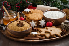 Christmas cookies and ingredients for baking on wooden tray Stock Image