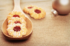 Christmas cookies with jam on a wooden spoon Royalty Free Stock Images