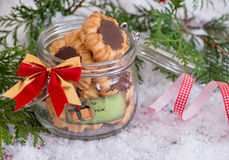 Christmas cookies in jar with festive decoration Stock Images