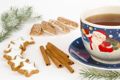 Christmas cookies and large tea cup. Christmas cookies, cinnamon sticks and large tea cup on light background stock photography