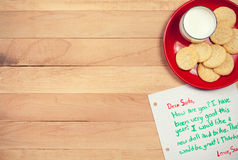 Christmas: Cookies and Letter to Santa. Background series of Christmas related items with lots of copyspace, on a wooden table setting Royalty Free Stock Image