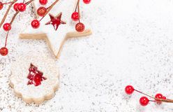 Christmas Cookies. Christmas Linzer cookies decorated with powdered icing sugar and red decorations in the background. Copy Space stock images
