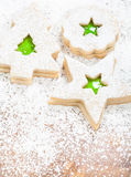 Christmas Cookies. Christmas linzer cookies decorated with powdered sugar and with green jam center royalty free stock image