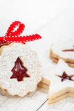 Christmas Cookies. Christmas linzer cookies decorated with powdered sugar and with red jam center stock photos