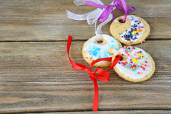 Christmas cookies lying on a wooden boards Stock Photo