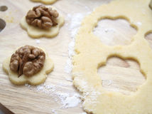 Christmas cookies. Making some christmas cookies with nuts royalty free stock photo