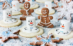 Christmas Cookies - melting snowman, gingerbread man, snowflake. Christmas Cookies - melting snowman, gingerbread man, gingerbread snowflake Stock Images