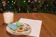 Christmas Cookies and Milk And Note and Tree Royalty Free Stock Image