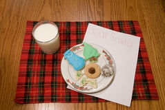 Christmas Cookies and Milk on Plaid with Note for Santa Royalty Free Stock Photo