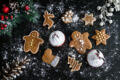 Christmas cookies and muffins Stock Photos