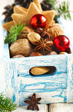 Christmas cookies, nuts and anise in wooden box. Stock Photo