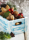 Christmas cookies, nuts and anise in wooden box. Royalty Free Stock Image