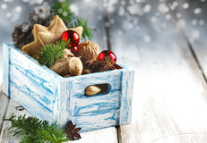 Christmas cookies, nuts and anise in wooden box. Royalty Free Stock Photography