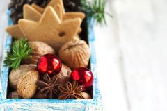 Christmas cookies, nuts and anise in wooden box. Stock Photography