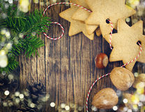 Christmas cookies, nuts, pine cones and fir branches Stock Photography