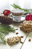 Christmas cookies with nuts on a table. Christmas cookies with nuts and decorations Royalty Free Stock Image