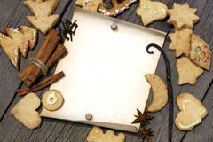 Christmas cookies and old vintage blank paper. On wooden boards royalty free stock photos