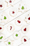 Christmas cookies. Overhead view of Christmas linzer cookies with Jam arranged on a white wooden background stock photo